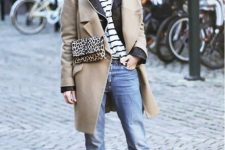 With white hat, beige coat, cropped jeans, striped shirt and black ankle boots