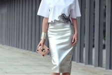 With white loose crop shirt, mini clutch and silver pumps