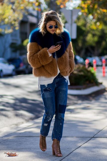 With white loose shirt, distressed jeans and brown lace up boots