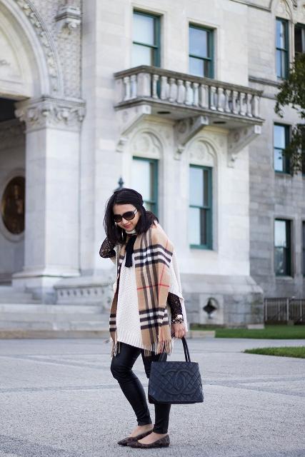With white oversized sweater, skinny pants, printed flat shoes and tote bag