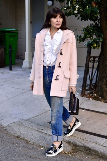With white ruffled blouse, cuffed jeans, black mini bag and printed shoes