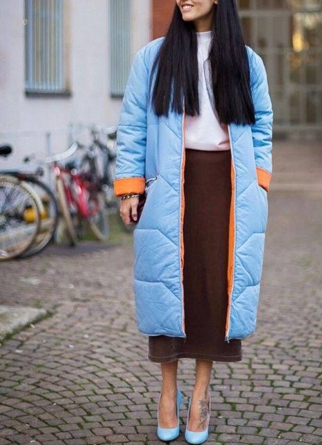 With white shirt, brown midi skirt and light blue pumps