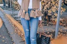 With white shirt, distressed skinny jeans, printed tote bag and ankle boots