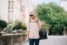 With white shirt, jeans and black tote bag