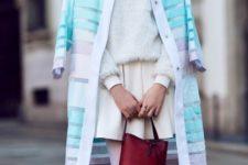 With white sweater, skater skirt and marsala bag