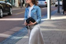 With white t-shirt, denim jacket, black velvet bag and white sneakers