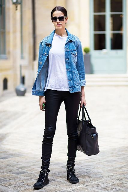 With white t-shirt, denim jacket, leather pants and tote bag