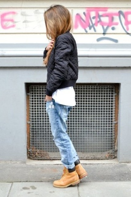 With white t-shirt, puffer jacket and loose jeans