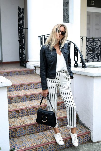 With white top, black jacket, black bag and white flat shoes