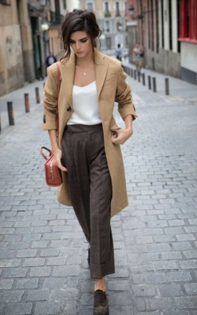 With white top, brown coat, brown bag and lace up shoes