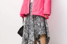 With white turtleneck, black bag, zebra printed skirt and printed lace up boots