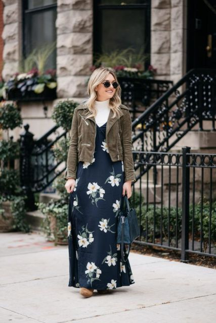 With white turtleneck, gray suede jacket, navy blue bag and boots
