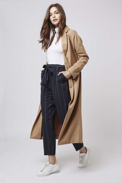 With white turtleneck, white sneakers and beige maxi coat