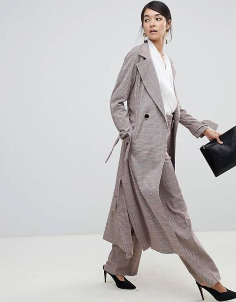With white wrap blouse, checked pants, black clutch and black mules