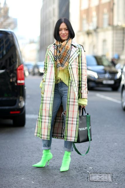 With yellow shirt, cuffed jeans, green boots, checked midi coat and bag