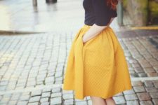 With yellow skirt and black pumps