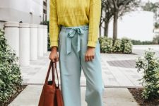 With yellow sweater, brown tote bag and brown mules