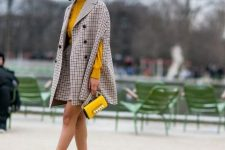With yellow sweater, checked mini skirt, yellow mini bag and black flat shoes