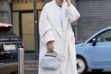 a beautiful monochromatic look with a white tee, white pants, a creamy midi coat, a white bag and shoes
