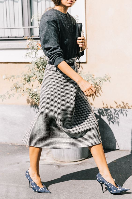 a black long sleeve top, a grey tweed midi skirt and navy polka dot shoes for a monochromatic look