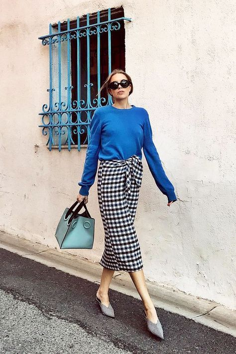 a blue long sleeve top, a tweed midi skirt, grey mules and a green bag for a colorful look
