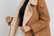 a brown oversized shearling coat with tan fur is a stylish winter outerwear piece to go for