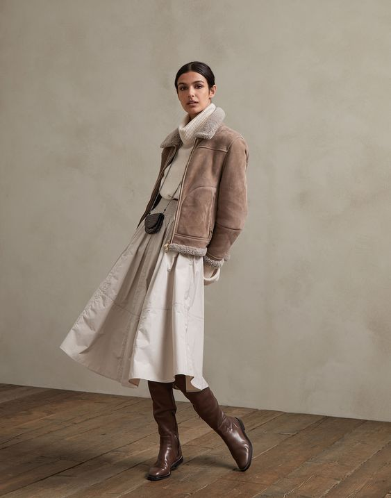 a catchy winter look with a creamy sweater, a creamy midi skirt, a brown short shearling coat and brown boots