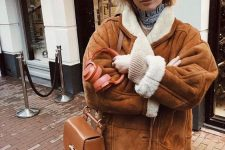 a comfy brown shearling coat with white fur, a matching brown bag for a stylish winter look