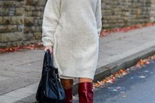 a dove grey over the knee sweater dress, fuchsia boots, a black bag for a bold look