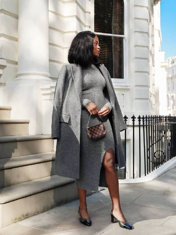 a grey midi sweater dress with a slit, black slingbacks, a grey midi coat and a printed bag