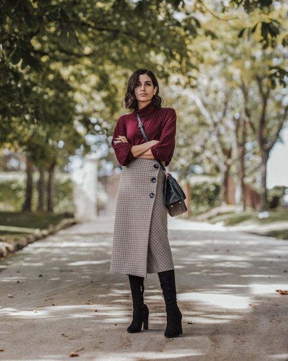 a purple turtleneck, a tweed midi skirt on buttons, black sock boots and a black bag for fall and winter