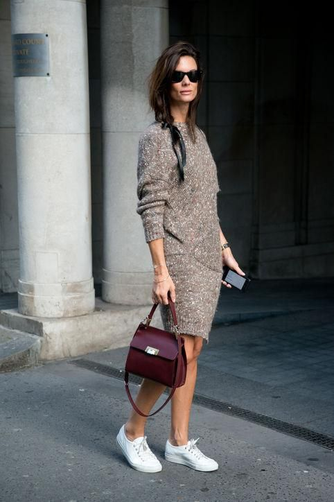 a short fitting brown sweater dress, white sneakers, a burgundy bag for a comfy look