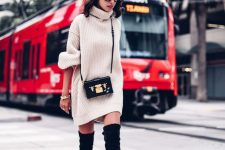 a short neutral sweater dress, black thigh high boots, a black bag with gold detailing