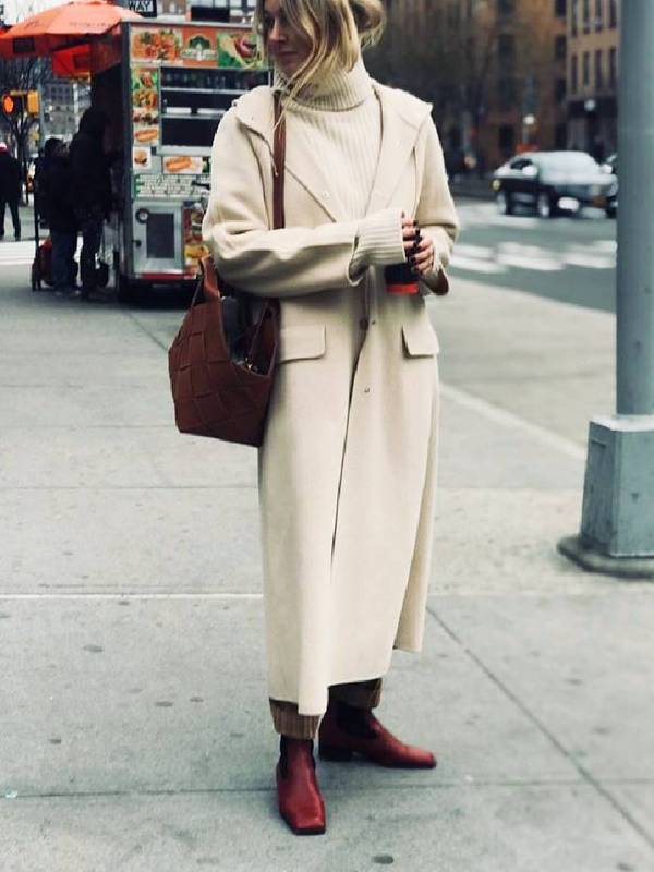 a stylish minimal look with a white sweater, a creamy midi coat, red square toe boots and a red woven bag