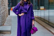 a super bold look with a purple sweater dress, a matching coat, a pink bag, black boots and a beret