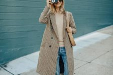 a tan sweater, blue skinnies, tan moccasins, a plaid midi coat and a gray cap for fall or winter