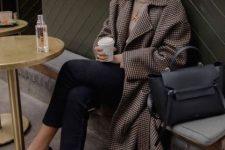 a tan turtleneck, black cropped jeans, black moccasins, a plaid midi coat and a black bag for work