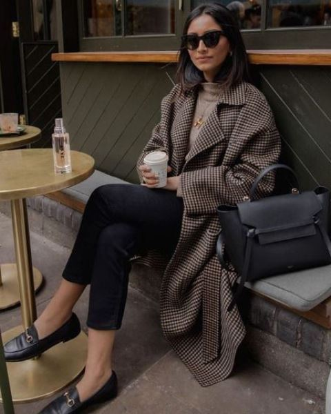 a tan turtleneck, black cropped jeans, black moccasins, a plaid midi coat and a black bag for work