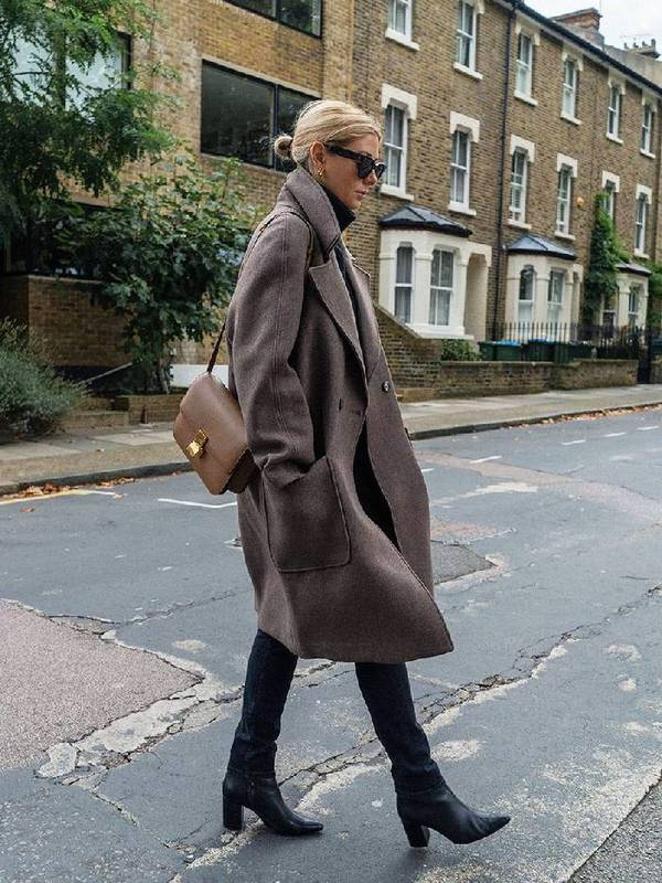 a total black look with a grey winter midi coat and a tan bag is stylish and timeless