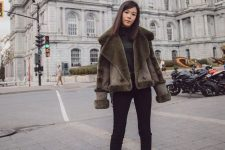 a total black look with jeans, a turtleneck, boots with zips and a dark green shealing coat with a minimal desire