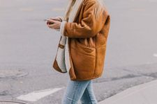 a vintage-style amber shearling coat with white fur and amber boots for a stylish winter look