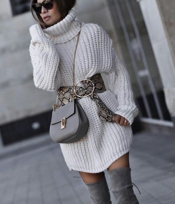 a white chunky knit sweater dress, a snakeskin belt, a grey bag and grey thigh high boots