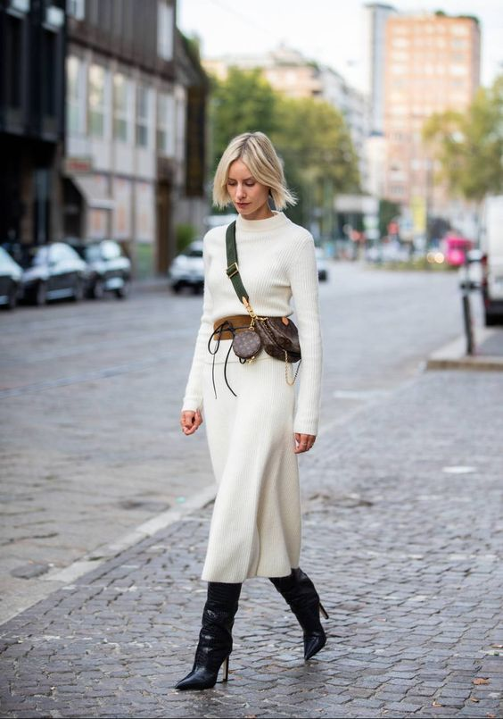 a white fitting midi dress, a brown belt, black boots and brown bags for a stylish and chic outfit