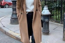 a white sweater, a black skirt and boots, a tan midi coat and a black bag for a monochromatic winter look