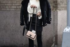 a white sweater, a black skirt, boots, a black short shearling coat and a blush bag for winter