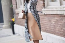 a white top, a tan midi skirt, a plaid midi coat, red slingbacks and a tan square bag for fall