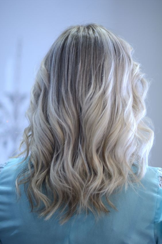 blonde air touch highlights on wavy hair are a very romantic and girlish idea to go for