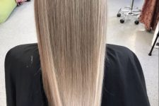 blonde airtouch highlights all over the hair create an absolutely natural look with a modern feel