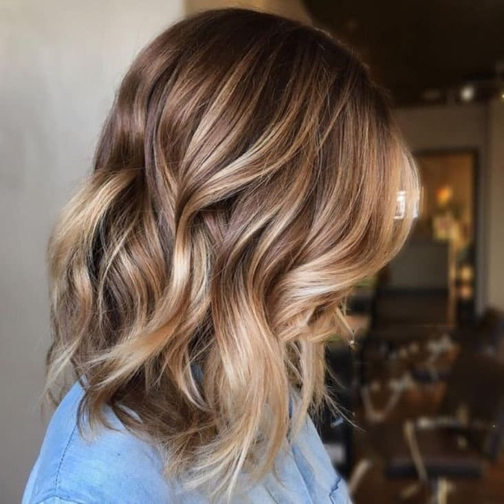 chestnut hair with blonde airtouch highlights and waves is beautiful and very stylish idea