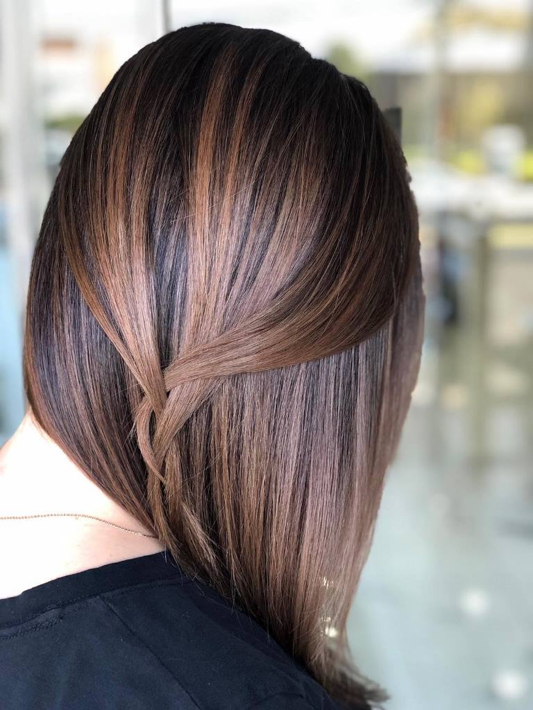 dark hair with chetnut airtouch highlights is a very bold and edgy idea to go for